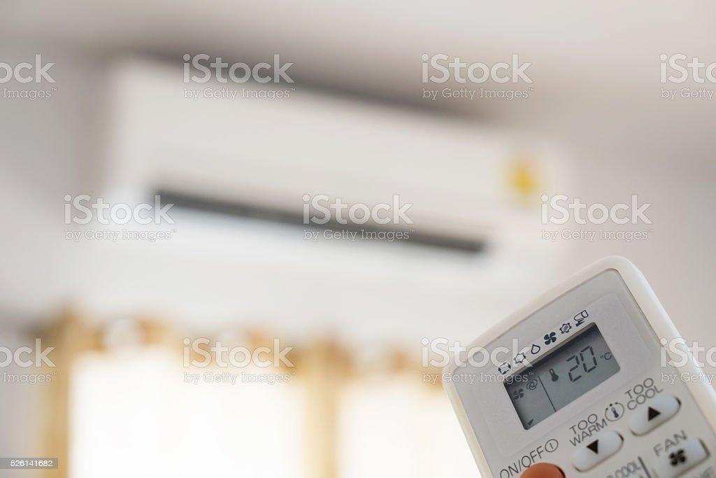 Close-up air condition remote, controlling temperature stock photo