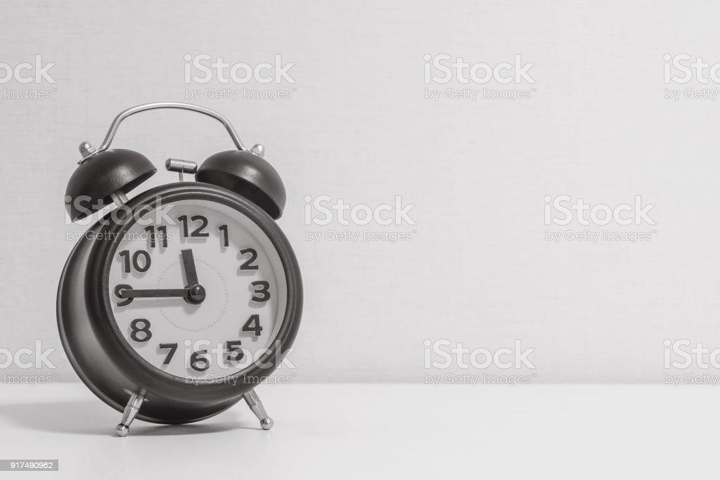 Closeup Alarm Clock Show A Quarter To Twelve Oclock Or 1145 Am
