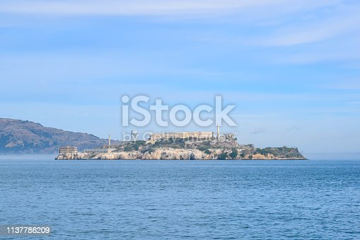 Close-up view of Alcatraz Island seen from San Francisco Pier in Fisherman's Wharf District on a sunny day.