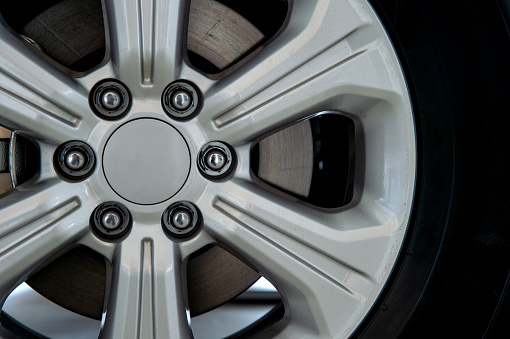istock closeup alloy car wheels with soft-focus and over light in the background 1058291032