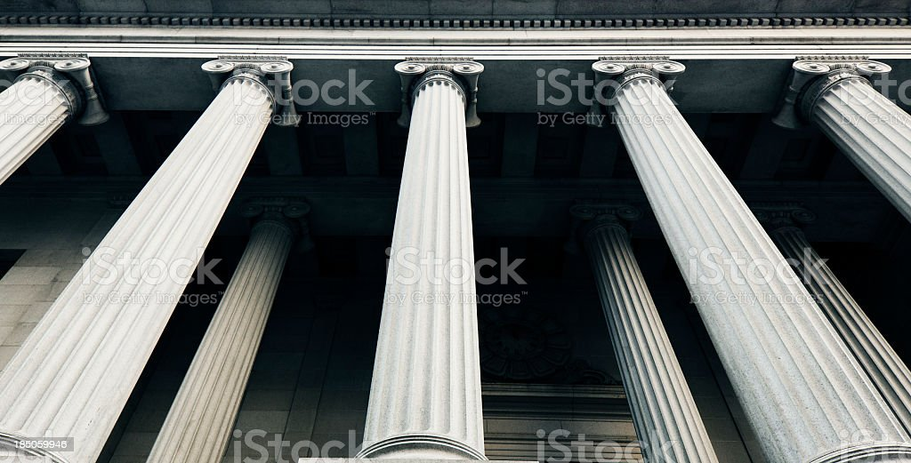 Close-up angled photo of classical columns stock photo