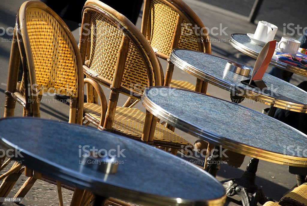 Close-up angled view of the tables on a Parisian terrace royalty-free stock photo