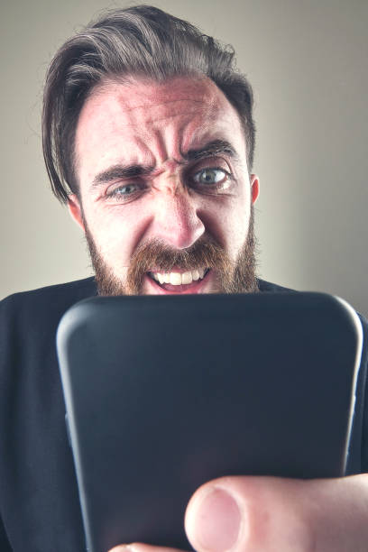 Close-up angry man on the phone - foto stock