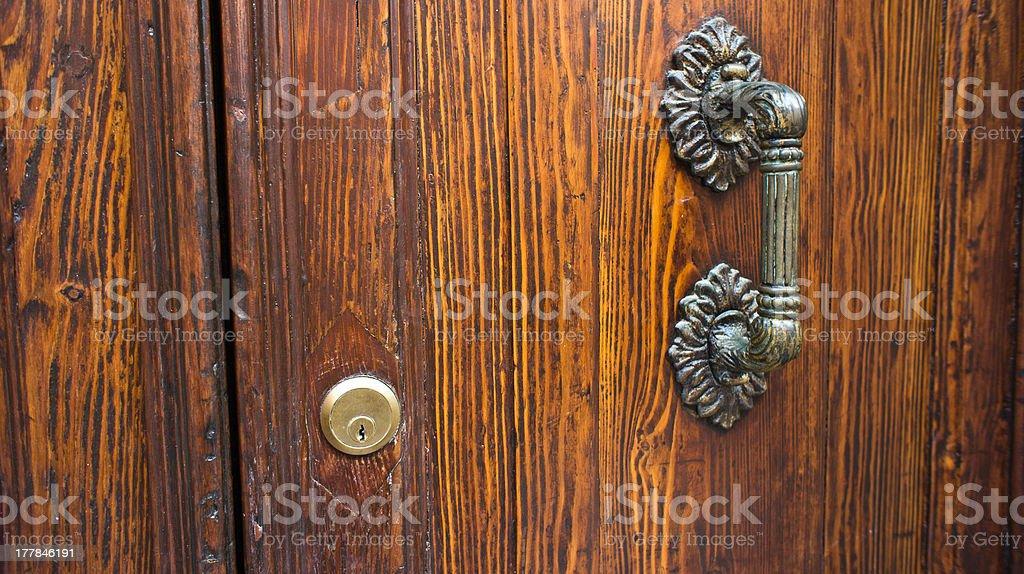 Closeup antique handle on the wooden door royalty-free stock photo
