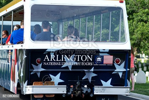 Arlington, Virginia, USA - May 24, 2015: Close-up of visitors riding a tour trolley as they explore Arlington National Cemetery over Memorial Day weekend.