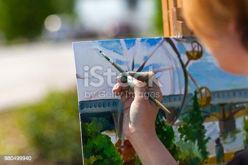 istock A close-up artist paints 980499940