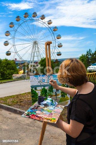 655303558 istock photo A close-up artist paints 980500184