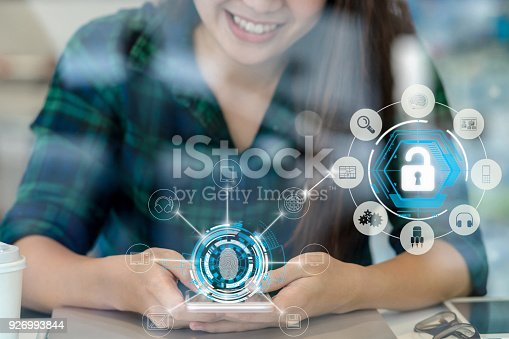istock Closeup Asian businesswoman hand using the smart mobile phone with happiness action to Fingerprint scan for biometric authentication to unlock security, Business Technology sceurity Concept 926993844