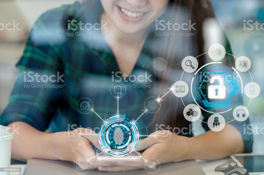 Closeup Asian businesswoman hand using the smart mobile phone with happiness action to Fingerprint scan for biometric authentication to unlock security, Business Technology sceurity Concept stock photo