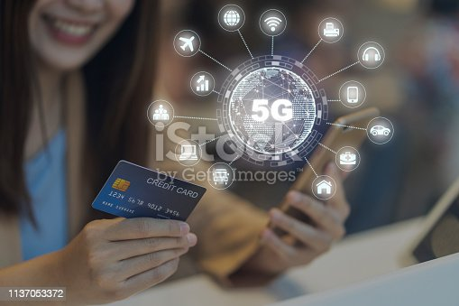 istock Closeup Asian woman using credit card by mobile for 5G technology with various icon internet of thing in department store, IOT and cashless concept, credit card mockup 1137053372