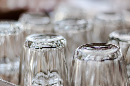 closeup at bottom of upside down drinking glasses