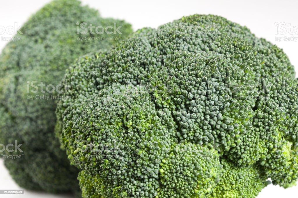 Closeup at two broccoli heads. stock photo