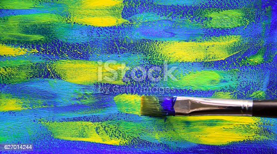 istock Closeup background of brush and palette. 627014244
