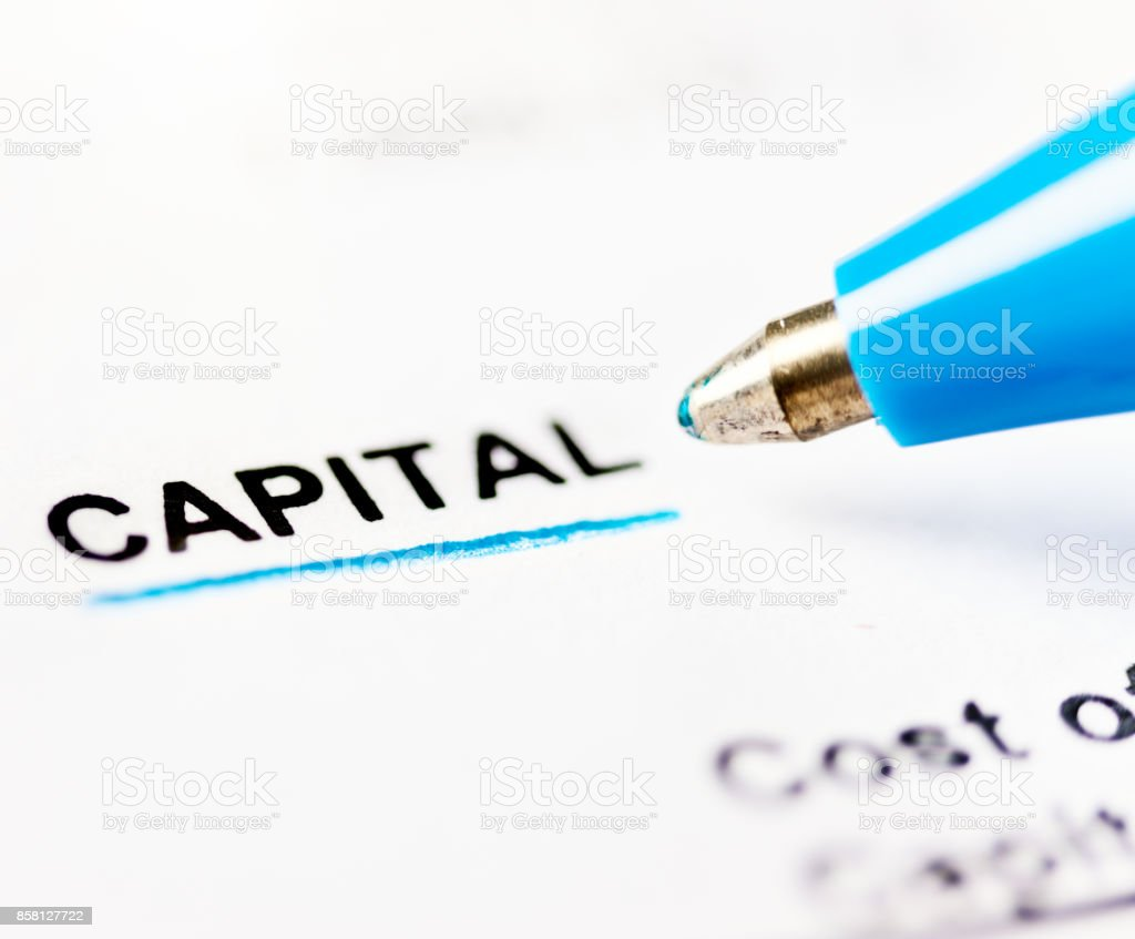 Close-up ballpoint pen underlines 'capital' in document stock photo
