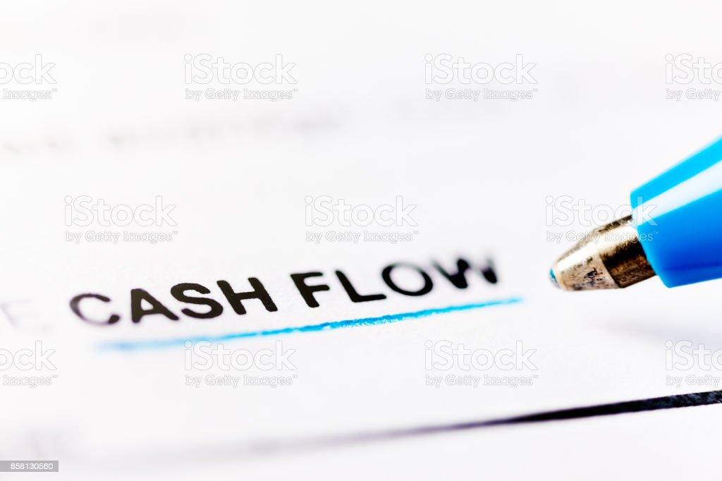 Close-up ballpoint pen underlines 'cash flow' in document stock photo