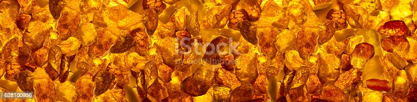 istock closeup baltic amber stones rectangular lie on a flat surface 628100936
