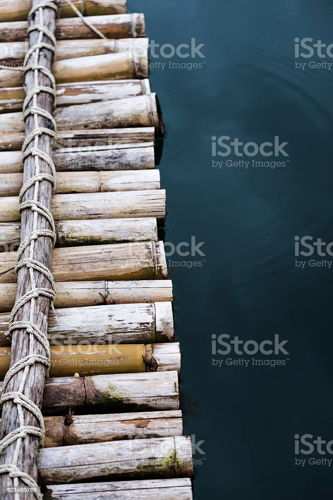 Close-up bamboo raft on the water stock photo