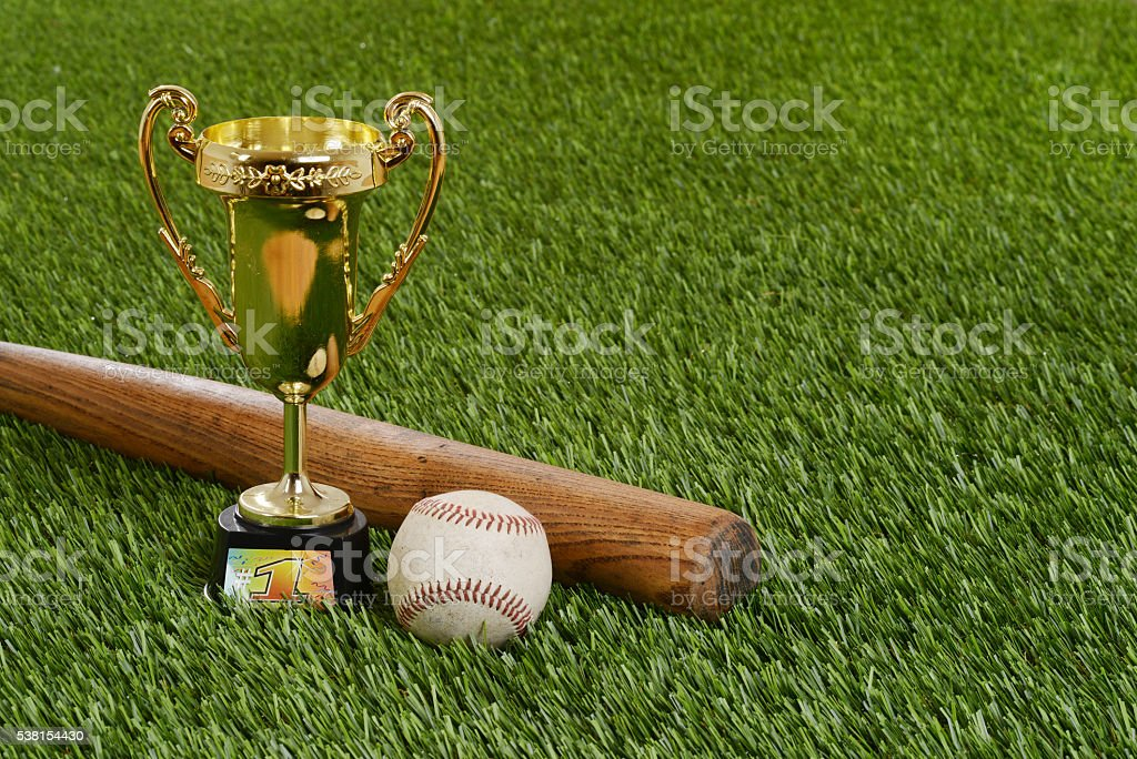 closeup baseball trophy with bat and hard ball stock photo