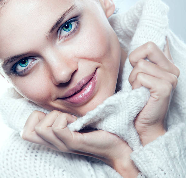 Close-up beautiful face of woman with white sweater stock photo