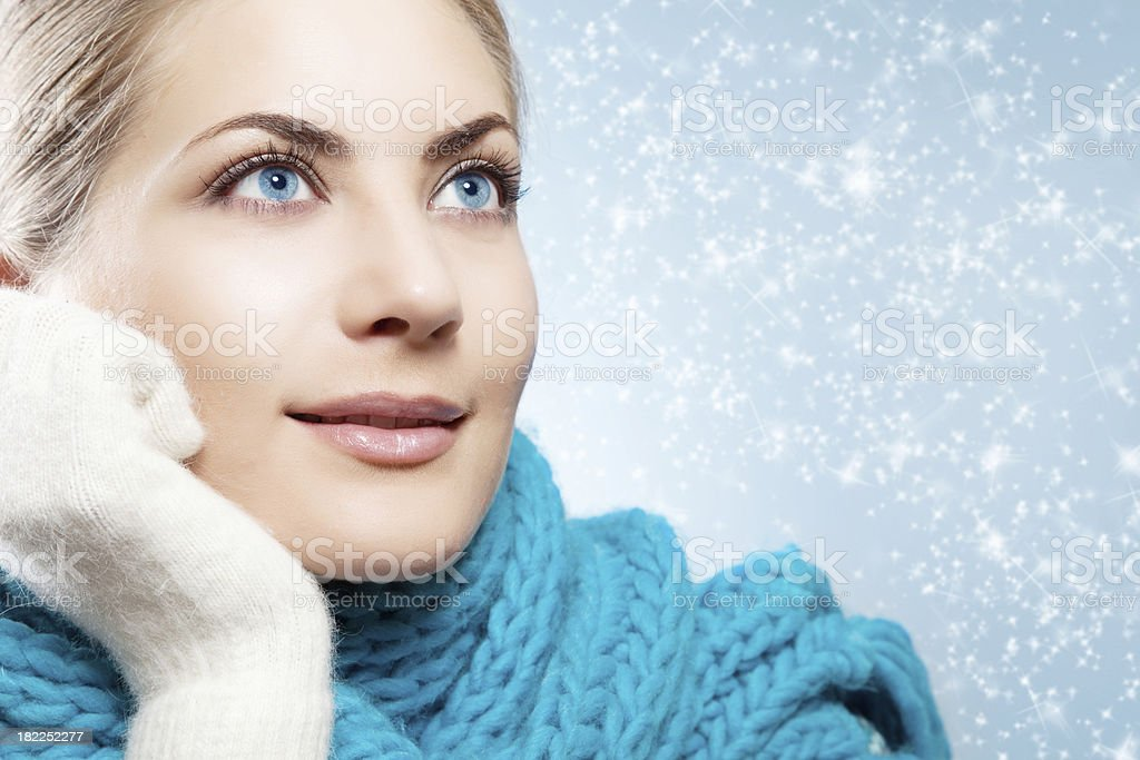 Close-up beautiful face of young woman with blue  scarf royalty-free stock photo