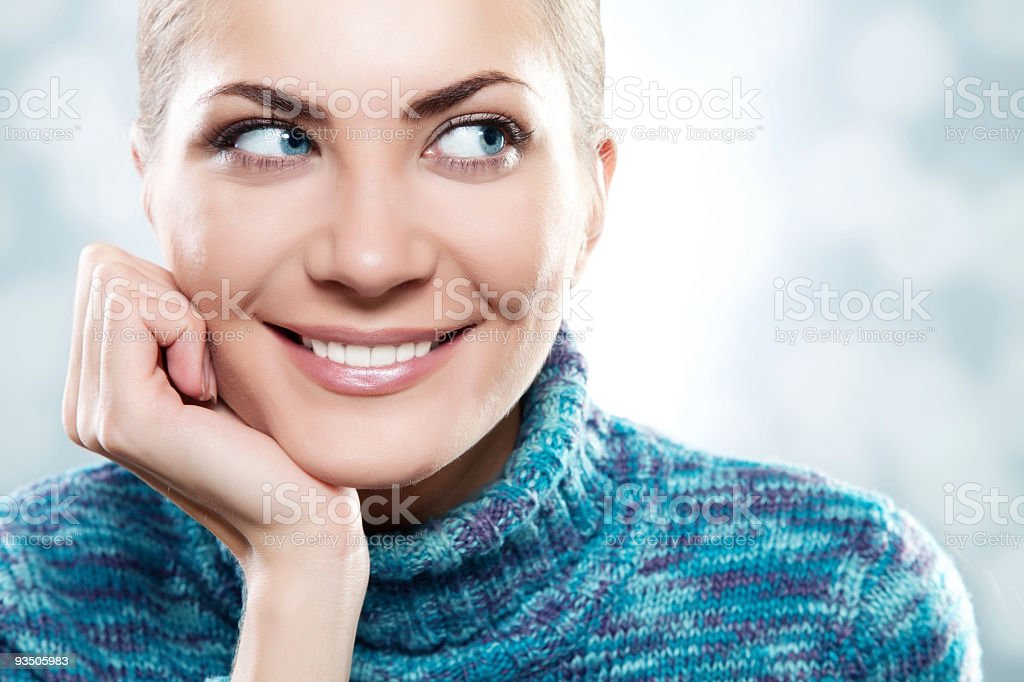 Close-up beautiful face of young woman with blue sweater royalty-free stock photo