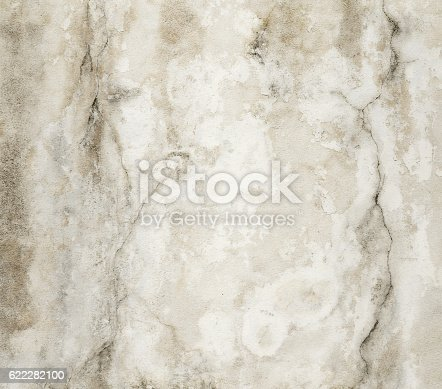 istock Close-up beige cracked grunge old wall texture concrete cement background 622282100