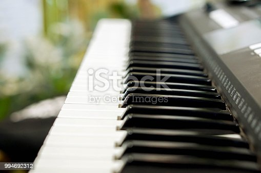 istock Closeup black and white electronic organs keyboard on blurry background. 994692312
