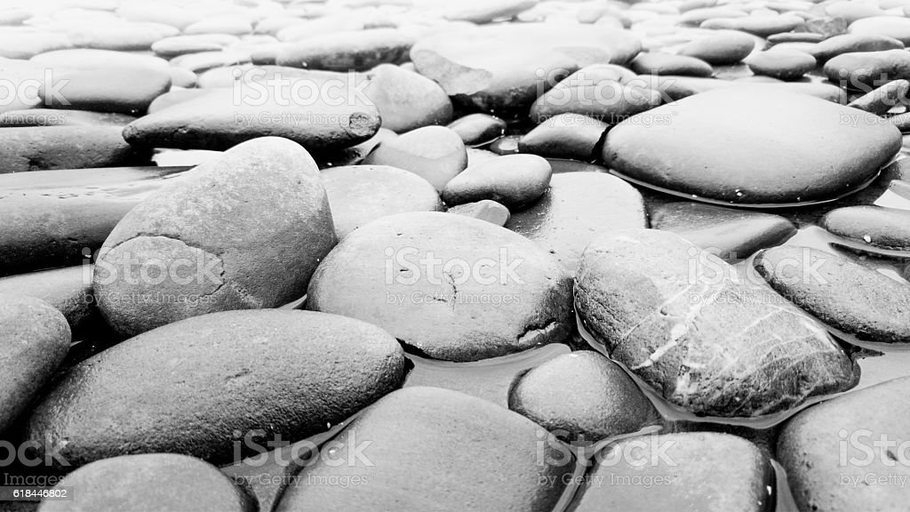 Closeup black and white photo of stones in river stock photo