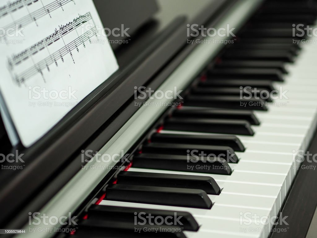 Close up black and white piano keys and musical notes royalty free stock photo