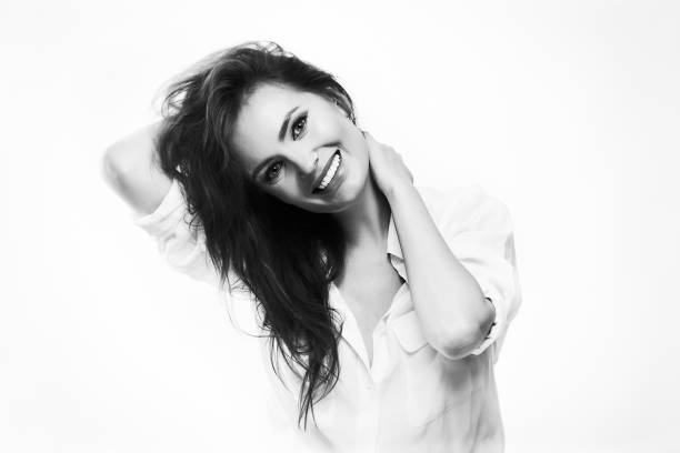 Closeup black and white portrait of a beautiful smiling woman, stock photo