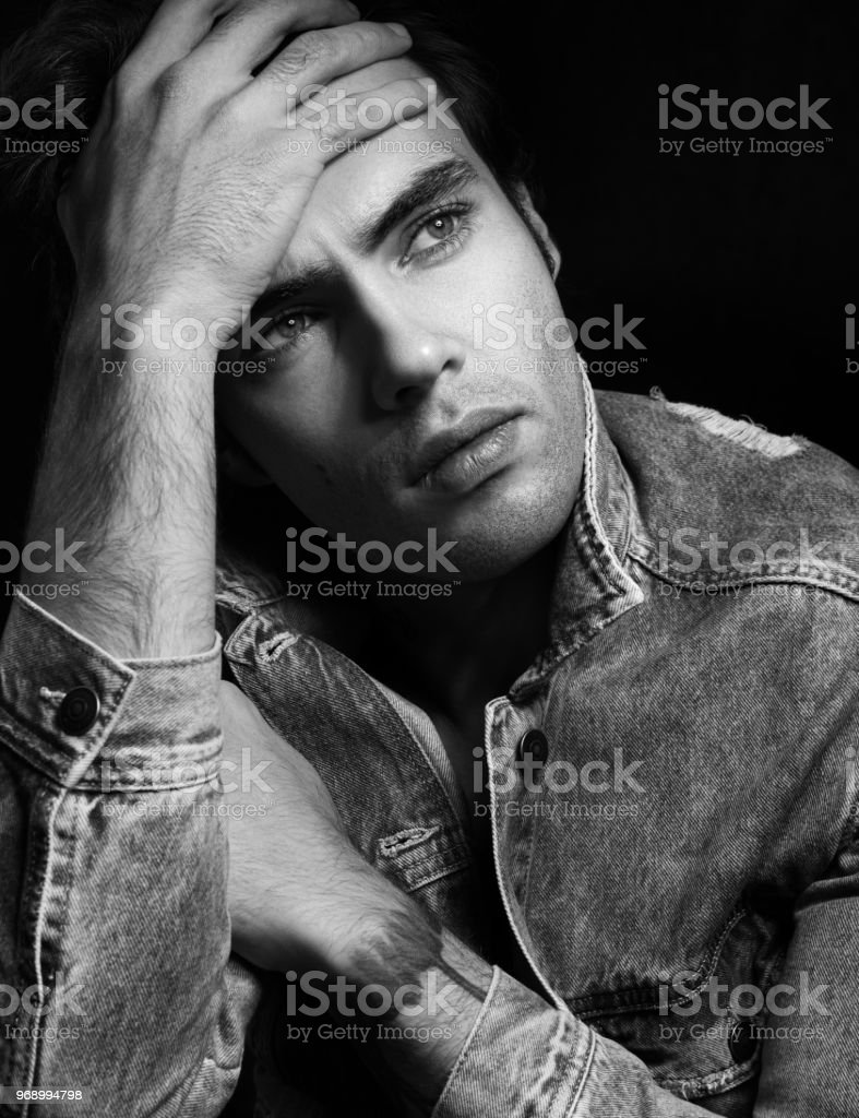 Closeup black and white portrait of pensive young men sad news royalty free stock