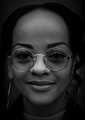 istock Close-up black and white portrait of young woman 1204787027