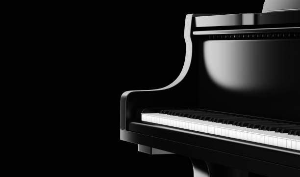 closeup black grand piano isolated on black background stock photo