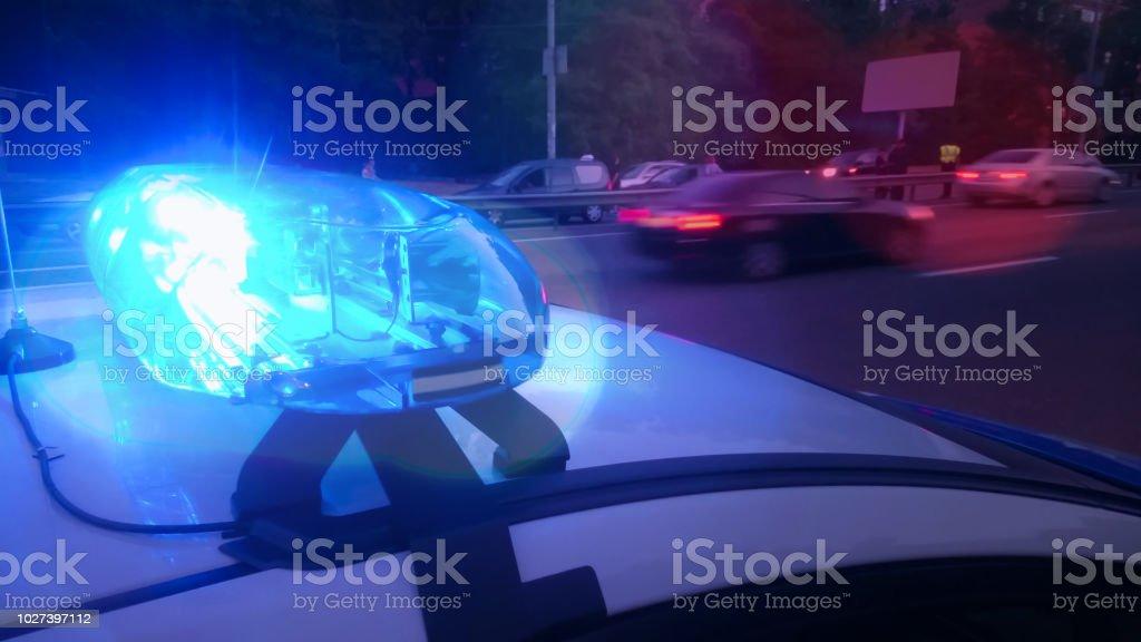 Closeup Blinking Strobe Lights On Police Car Blue Lightbar