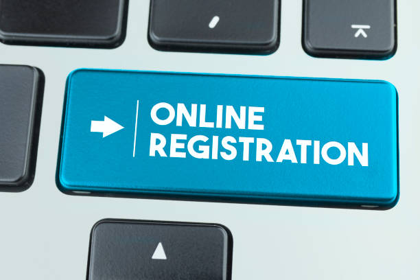 Close-Up Blue Laptop Keyboard With Online Registration Button. stock photo
