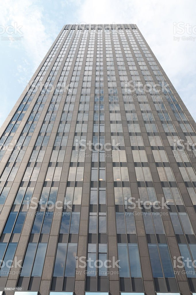 Close-up bottom view of glass skyscraper royalty-free stock photo