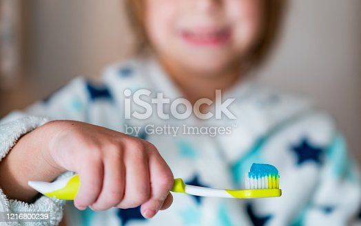 948443044 istock photo Closeup boy holding toothbrush with toothpaste 1216800239