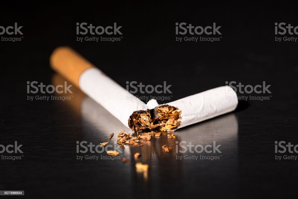 closeup broken cigarette, stop smoking stock photo