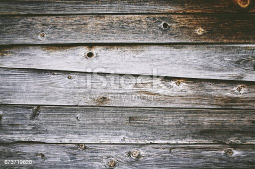 istock Close-up brown gray grunge old board wall texture 673719620