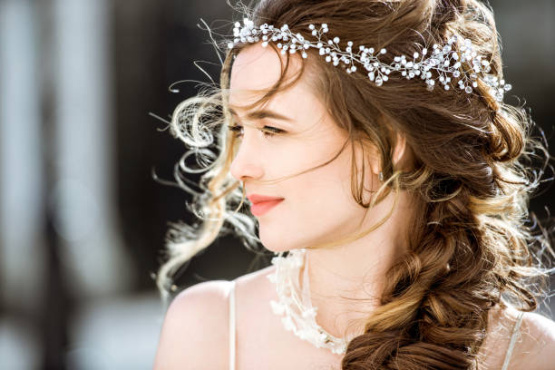 Closeup brunette bride with fashion wedding hairstyle and makeup stock photo