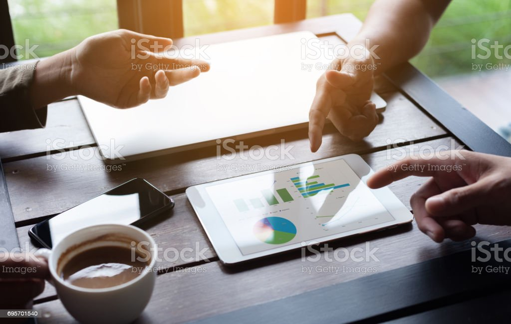 close-up business group meeting show analysis graph on tablet device stock photo