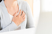 istock Closeup business woman having heart attack. Woman touching breast and having chest pain after long hours work on computer. Office syndrome, Healthcare And Medical concept. 1051826214
