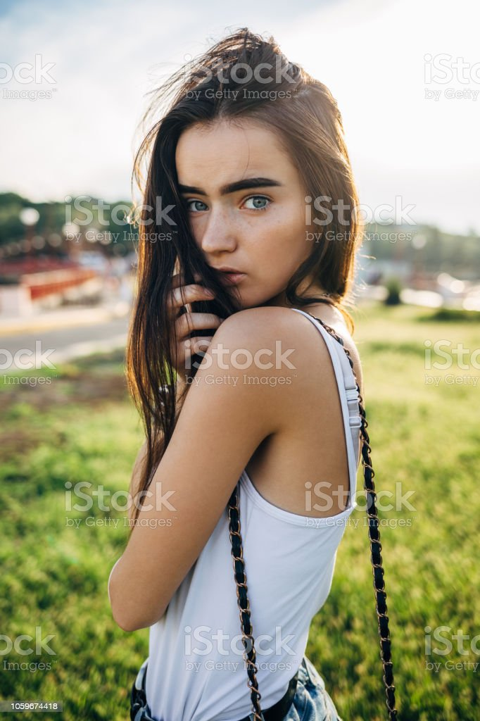 Closeup Candid Portrait Of Calm Young Woman Stock Photo