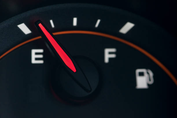 Close-up car dash board petrol meter on black background. stock photo