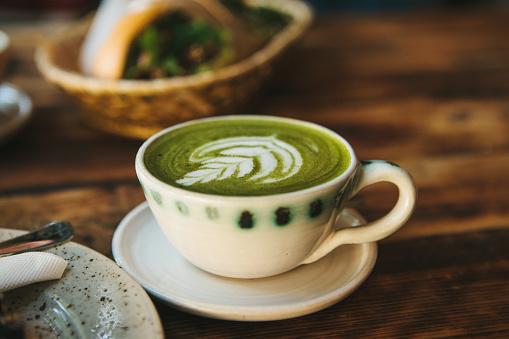 Close-up - ceramic cup with green tea called Matcha
