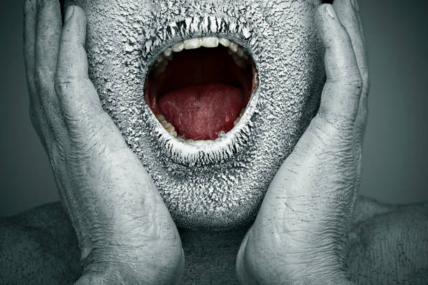 Close-up, chapped, dry painted human face screaming with open mouth stock photo