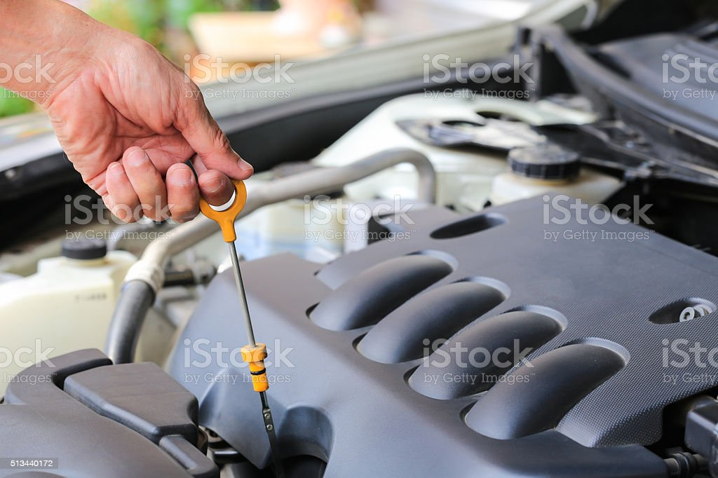 Close-up checking oil machine on a car. stock photo