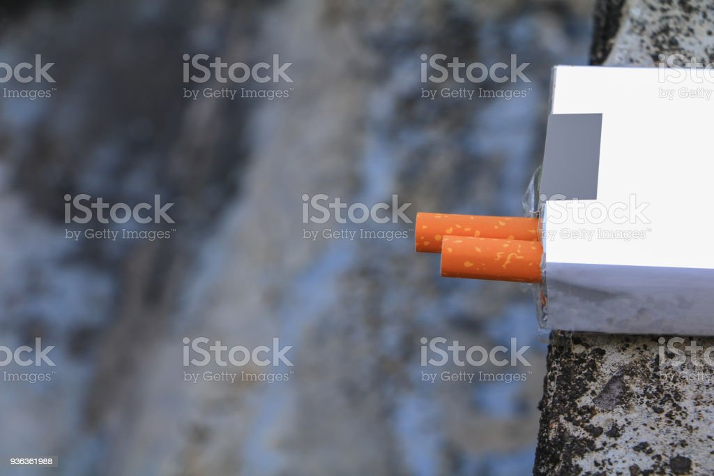 closeup cigarette in the package on cement background. concept Non-smoking day universal stock photo