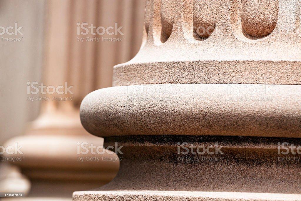 Closeup classical stone columns bases stock photo