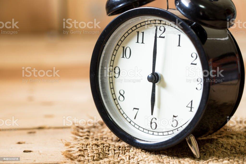 closeup clock face morning at 6 o\'clock, vintage clock composition...